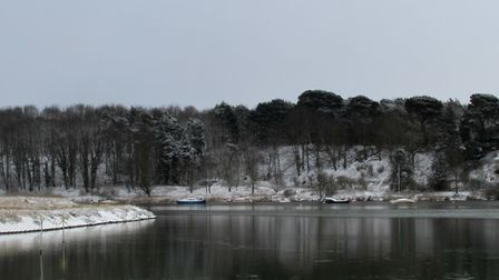 Tide Mill and snowy woods at the River Deben in Woodbridge. Picture: DAWN FORSDIKE