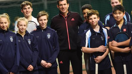 Tim Henman with some of the tennis academy pupils at Culford School, near Bury St Edmunds earlier th