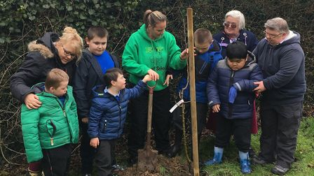 Pupils at Hillside Special School in Sudbury plant fruit trees this week to celebrate their Ofsted r