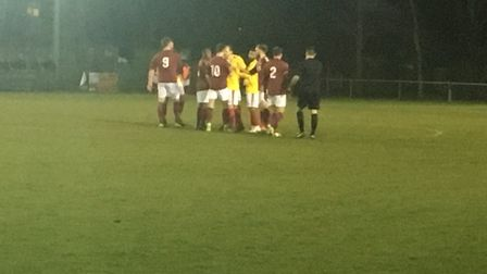 A melee ensues in the middle of the pitch as players square up to each other during a feisty affair