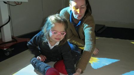 Pupil Holly Wagstaff and teaching assistant Kathleen Crossley on the 'magic carpet'.
