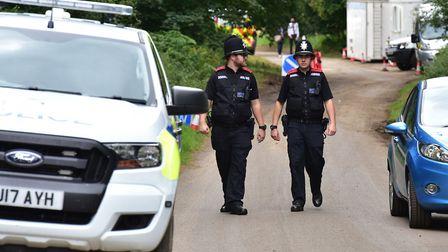 Police conduct checks near the scene in East Harling. Picture: NICK BUTCHER