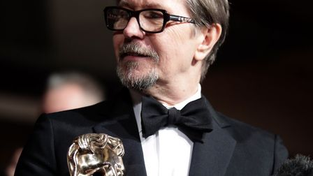 Gary Oldman with his leading actor award at the EE British Academy Film Awards after party, London.