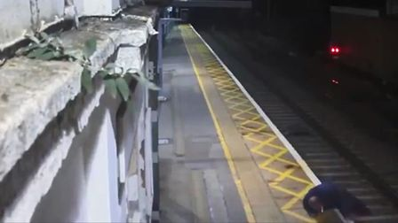 Still image from CCTV of drunk man climbing on train tracks at Harlow Mill station. Picture: PRESS A