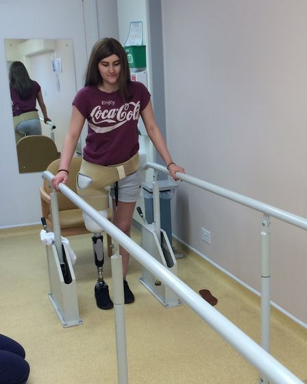 Kim Sale learning to walk with her first NHS prosthetic leg. Picture: SUPPLIED BY KIM'S FAMILY