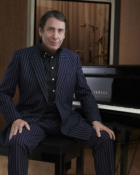Jools Holland sitting at the piano. Jools will be playing Nowton Park as part of the Bury Festival 2