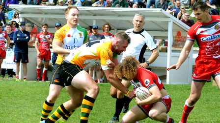Action from the ninth Greene King IPA International Rugby Sevens Tournament at the Haberden in Bury