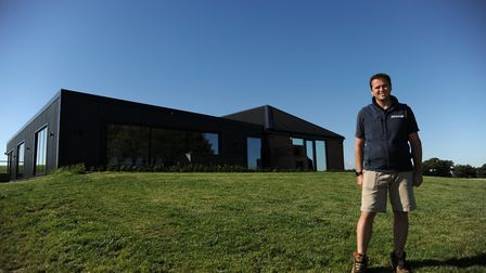 Andrew Bryce, owner of The Suffolk Escape in front of The Sheepyard Barn. Picture: SARAH LUCY BROWN