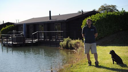 Andrew Bryce, owner of The Suffolk Escape in front of the log cabins. Picture: SARAH LUCY BROWN