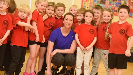 Olympic Swimmer Amy Smith with the Reception class at Hindlesham and Chattisham Primary Schoool. Pic