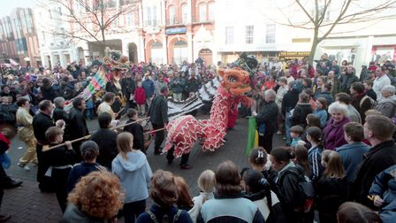 Crowds gather to watch the dance of the dragons