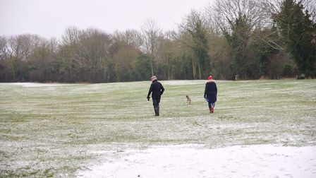 Walkers enjoy the snow at Framlingham Castle. Picture: SARAH LUCY BROWN