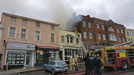 Firefighters quickly surrounded the flames at Whispers wine bar to prevent the flames spreading to o