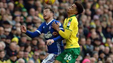 Joe Garner, pictured battling with Norwich's Jamal Lewis last Sunday, should return to the Town team
