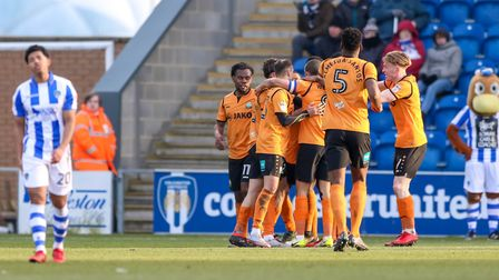 Courtney Senior, left, looks distraught as Barnet players celebrate Alex Nicholls' goal, which prove