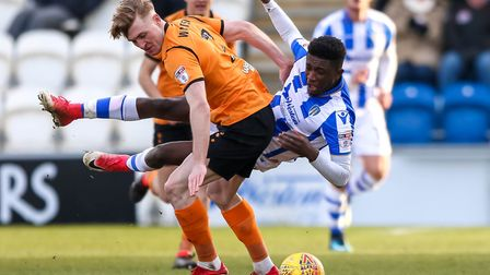 Junior Ogedi-Uzokwe is fouled by Ryan Watson early in the second half of the U's 1-0 home defeat at