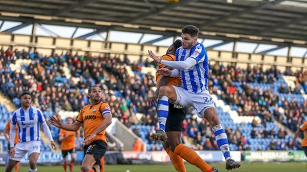 Ryan Inniss, who was recalled to the U's side, battles with Barnet's Ricardo Santos during the secon