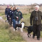 Phil Brown, of the Share - With Care conservation consultancy, walks his dog Max with Happy Paws Dog