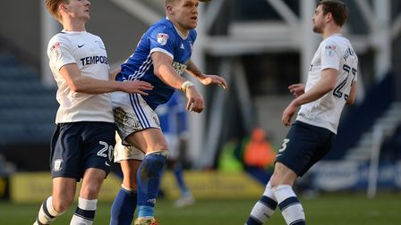 Town's Martyn Waghorn under pressure at Deepdale. Picture Pagepix