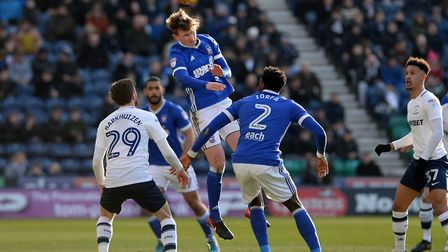 Callum Connolly gets up to win a header at Deepdale Picture Pagepix