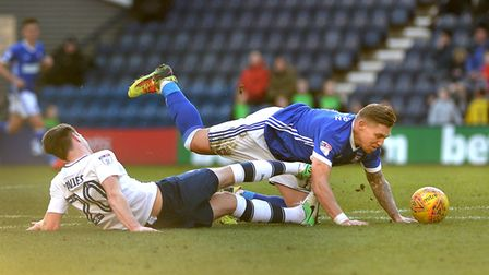 Martyn Waghorn tangles with Preston's Ben Davies and is brought down at Deepdale Picture Pagepix