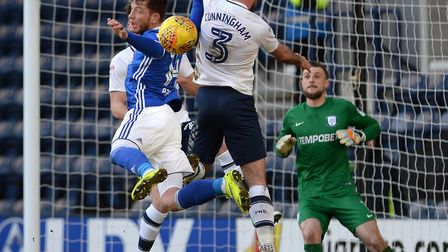 Joe Garner leaping for a first half cross at Preston Picture Pagepix