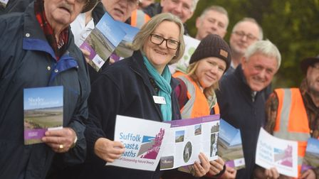 Launch guests hold copies of the new Suffolk Coast & Heaths AONB Shotley Walk Explorer Guide. Pictur