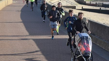 Graeme Knott, pushing a buggy, on his way to second spot at Saturday's Harwich parkrun.