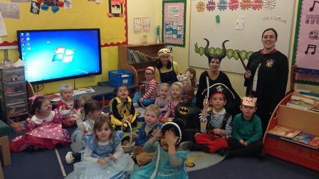 Pupils enjoy the snow at Ravenswood Primary School - and held an early World Book Day event. Picture