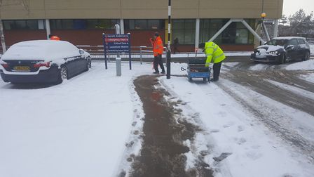 The estates team at Ipswich Hosptial salting and clearing paths. Picture: GARETH PERKINS