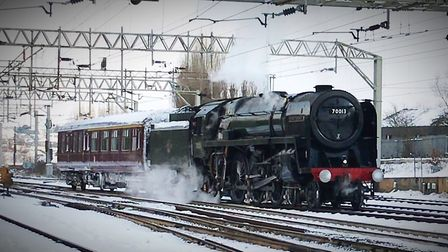The historic Oliver Cromwell steam engine glides through Colchester station on one of the coldest da