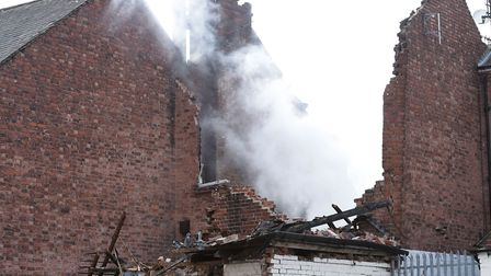 The scene on Hinckley Road in Leicester after a suspected explosion and the subsequent fire destroye