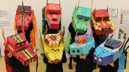 The pupils at Wilby Primary School showcasing their colourful Chinese dragon models. Picture: ROISIN