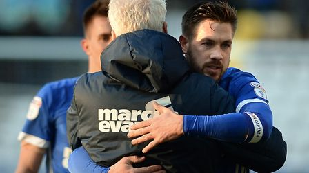 Mick McCarthy gets a hug from captain Luke Chambers after Ipswich Town's 1-0 win at Preston last Sat