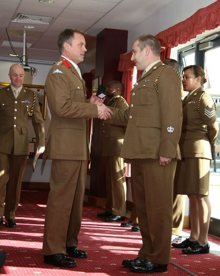 Warrant Officer Class 2 Rhydian Coleman is presented with Long Service and Good Conduct Medal by Col