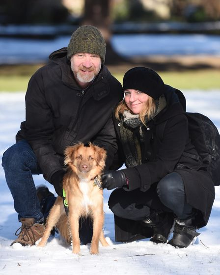 Martin and Rachel Haindl playing with their dog in Abbey Gardens. Picture: GREGG BROWN