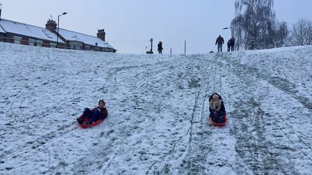 Cameron and Miley Nash on their sleds at the 'dip' next to West Suffolk College in Bury St Edmunds.