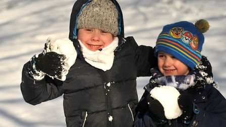 Hugo and Oscar French have fun in the snow. Picture: SARAH LUCY BROWN