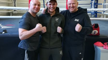 Billy Bird (centre) with his trainers Jon Thaxton (left) and Graham Everett (right). Picture: ALEX M