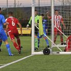 Rhys Barber and the ball are both in the back of the net as Felixstowes Dan Davis wheels away to ce