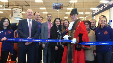 Mayor Terry Clements cuts the ribbon with Nigel Oddy, The Range CEO (far left), Aston Flint, store m