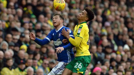 Joe Garner battles at Carrow Road in February with Jamal Lewis. Picture: PAGEPIX