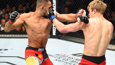 Arnold Allen, right, lands a left hook on foe Alan Omer in his UFC debut back in June 2015. Picture: