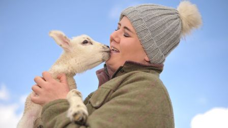 Farran Hessey with one of the lambs. Picture: SARAH LUCY BROWN
