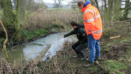 Environment Agency officer Trevor Bond points to a water deflector in the restored River Wang, near