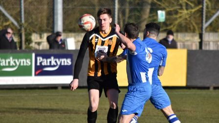 Stowmarket's Josh Mayhew battles for the ball against Saffron Walden. Could he hit the 60-goal mark