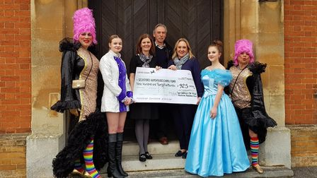The Company of Four cast of Cinderella present a cheque to Cathy O'Brien (third from left) and Amand