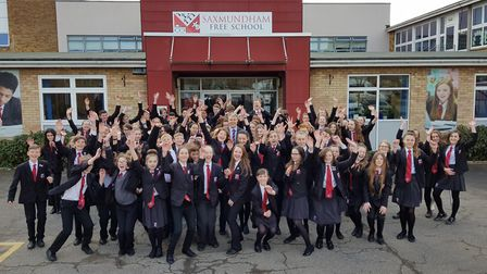 Saxmundham Free School students celebrate the school's 'Good' Ofsted result with (centre) headteache