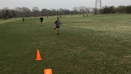 Cones and runners strewn across Colney Lane Playing Fields at last Saturday's parkrun. Picture: CARL
