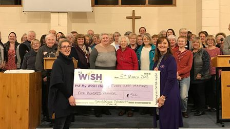 Members of the Dayspring Community Choir hand over £500 to Sue Smith, the campaign manager for the M
